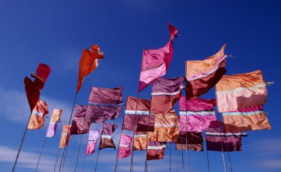 Lovely silk festival flags blowing in the wind with slight movement. These Glastonbury flags will be a welcome sight every morning!