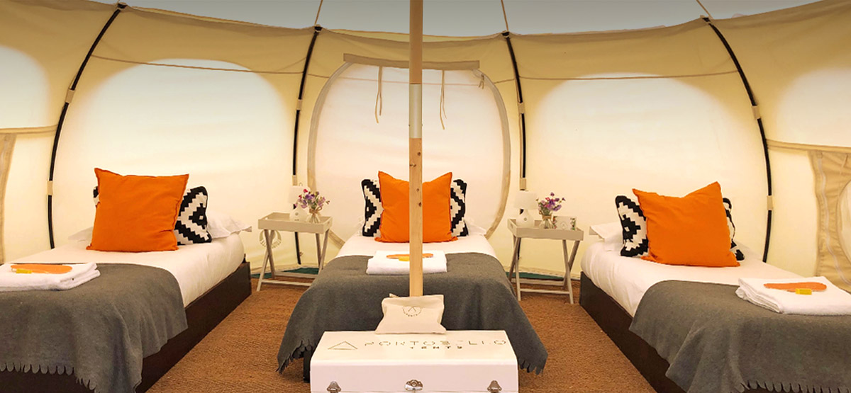 You could be sleeping in these real beds at Glastonbury Festival 2020! Luxury camping options for you and your family and friends. This Lotus Belle tent is set up with three single beds, complete with real duvet & pillows, clean linens, blankets and more!